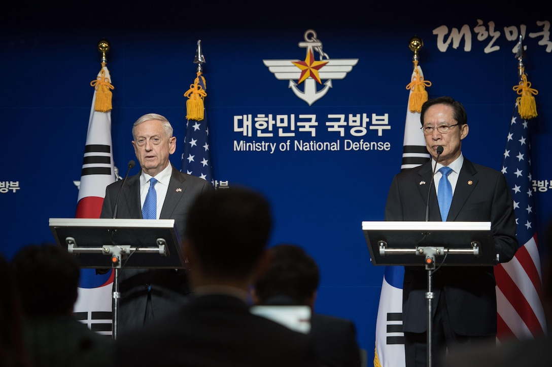 U.S. and South Korean defense leaders conduct a news conference.