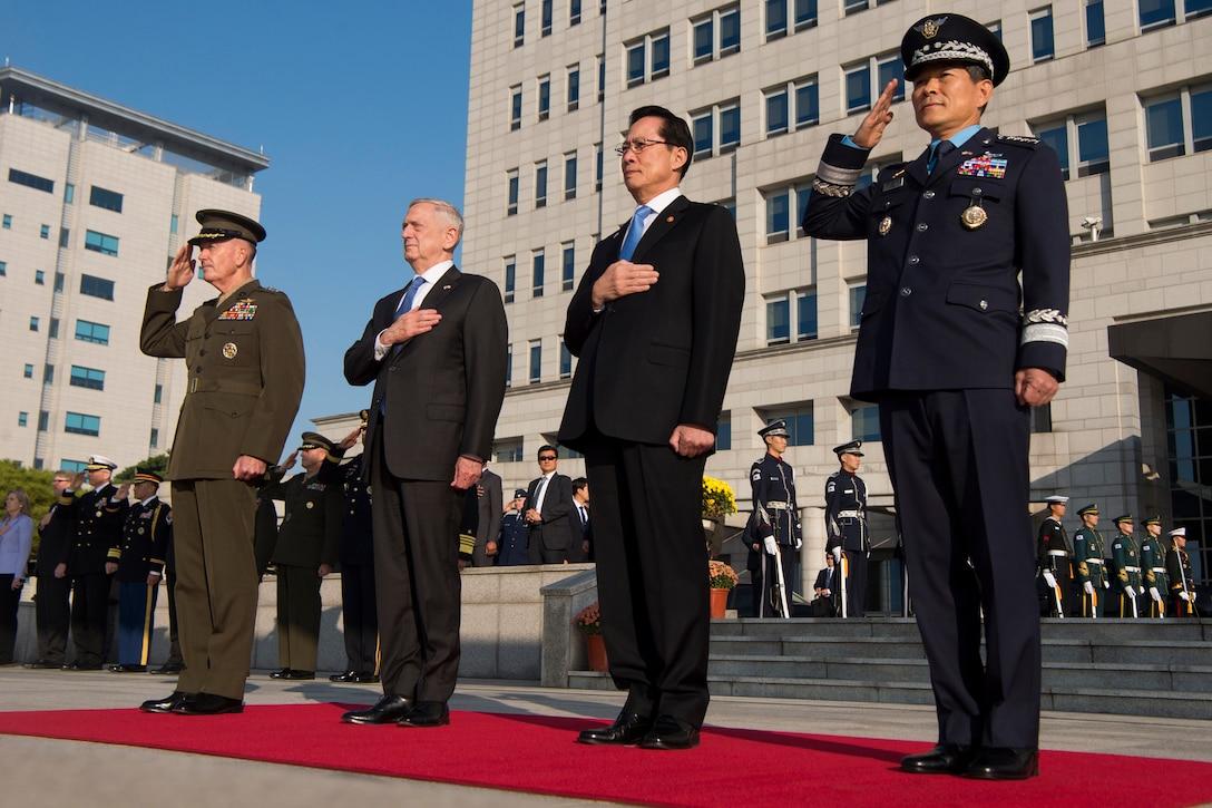U.S. and South Korean defense leaders render honors in Seoul, South Korea.