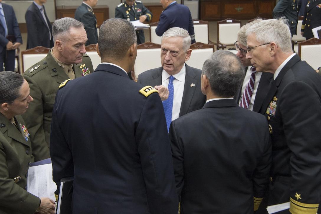 Defense leaders converse during security meetings in Seoul, South Korea.