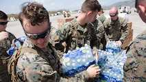 U.S. Marines with the 26th Marine Expeditionary Unit (MEU), unload emergency care items at the St. Thomas Cyril E. King Airport, U.S. Virgin Islands, Sept. 12, 2017. The 26th MEU worked jointly with Department of Defense services and Federal Emergency Management Agency staff to provide food, water, and other essential care items in support of Hurricane Irma relief efforts.
