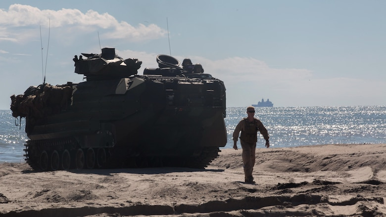 A U.S. Amphibious Assault Vehicle is guided onshore during exercise Bold Alligator 17 at Camp Lejeune, N.C., Oct. 25, 2017.  Bold Alligator 17 is a multinational, naval amphibious exercise that focuses on combined training of multiple forces executing complex shaping, amphibious, and sea basing operations to improve U.S. and coalition ship-to-shore capabilities.