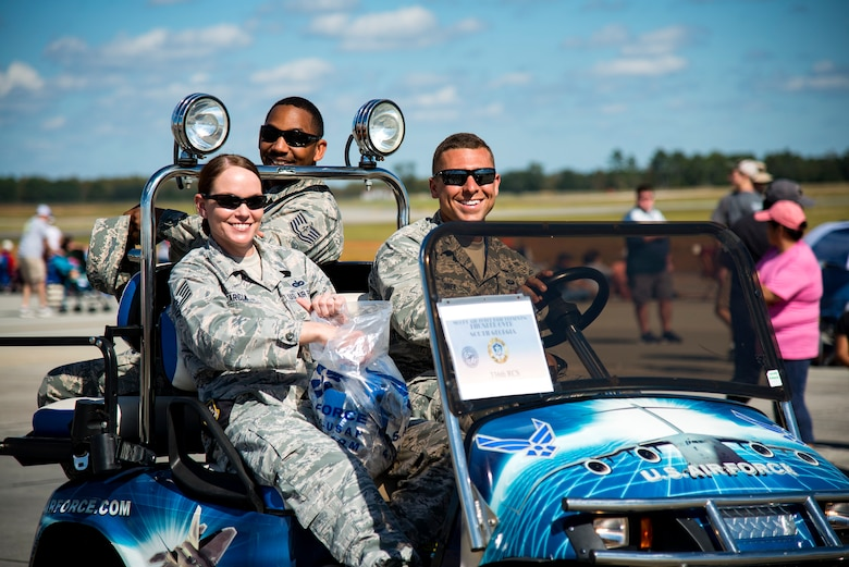 Airmen from the 336th Recruiting Squadron pose for a photo during the Thunder Over South Georgia Air Show, Oct. 28, 2017, at Moody Air Force Base, Ga. The air show is an opportunity for Moody to thank the local community for all its support, and exhibit air power. (U.S. Air Force photo by Airman 1st Class Erick Requadt)