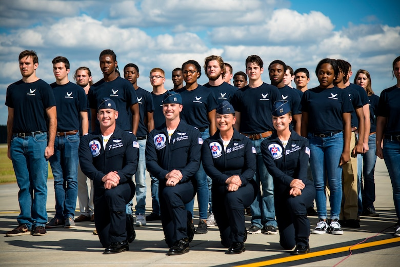 The U.S. Air Force Thunderbirds, along with members of the Delayed Entry Program, pose for a photo, Oct. 28, 2017, at Moody Air Force Base, Ga. The air show is part of the Air Force's 70th Air Force Birthday celebration demonstrating air and space power over the ages. (U.S. Air Force photo by Airman 1st Class Erick Requadt)