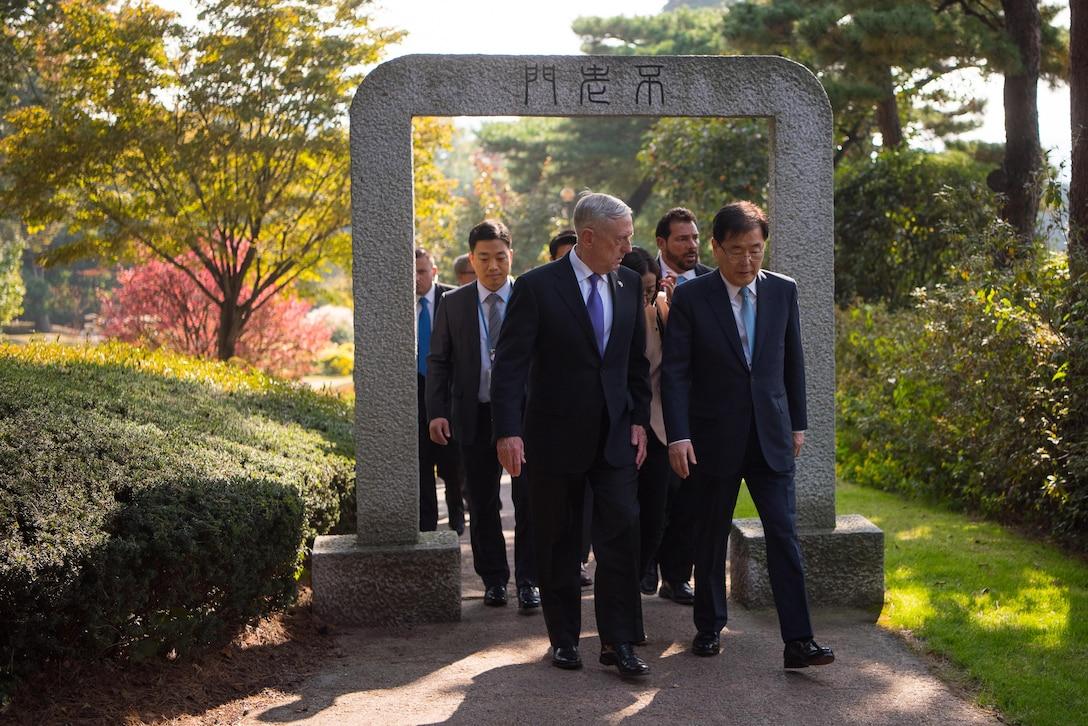 Defense Secretary Jim Mattis tours the presidential gardens in Seoul, South Korea.