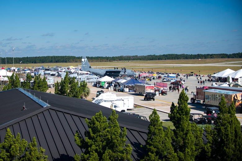 Spectators walk around and view the different attractions available the Thunder Over South Georgia Air Show, Oct. 29, 2017, at Moody Air Force Base, Ga. Throughout the show, guests viewed aircraft through the ages perform such as the P-51 mustang, a World War II fighter, and the Moody's own A-10C Thunderbolt IIs. (U.S. Air Force photo by Airman 1st Class Erick Requadt)