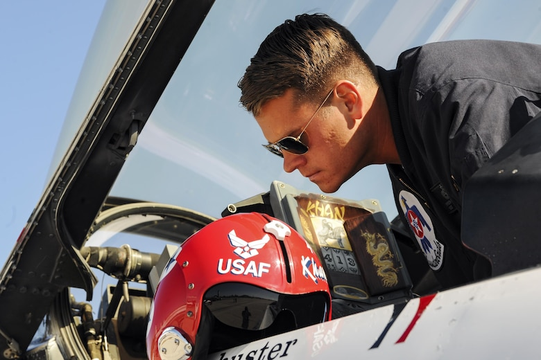 Staff Sgt. Bryson Schuster, U.S. Air Force Thunderbirds avionics technician, inspects the cockpit of a F-16C Fighting Falcon during the Thunder Over South Georgia Air Show, Oct. 29,2017 at Moody Air Force Base, Ga. Thunder Over South Georgia is part of the Air Force's 70th Air Force Birthday celebration demonstrating air and space power over the ages. (U.S. Air Force photo by Airman Eugene Oliver)