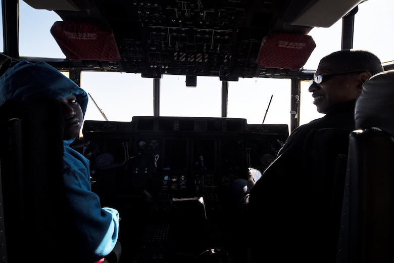 Paul Collier, local community member, and his son, Xavion, sit in the cockpit of a HC-130J Combat King during the Thunder Over South Georgia Air Show, Oct. 29,2017 at Moody Air Force Base, Ga. Moody opened its gates to the public for a free, two-day event as a way to thank the local community for their ongoing support of the base's mission (U.S. Air Force photo by Airman Eugene Oliver)