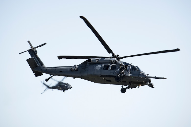 Two HH-60G Pave Hawks from the 41st Rescue Squadron fly during the Thunder Over South Georgia Air Show, Oct. 29, 2017, at Moody Air Force Base, Ga. The open house is an opportunity for Moody to thank the local community for all its support, and exhibit air power and it included aerial performances, food, face painting and much more. (U.S. Air Force photo by Staff Sgt. Ryan Callaghan)