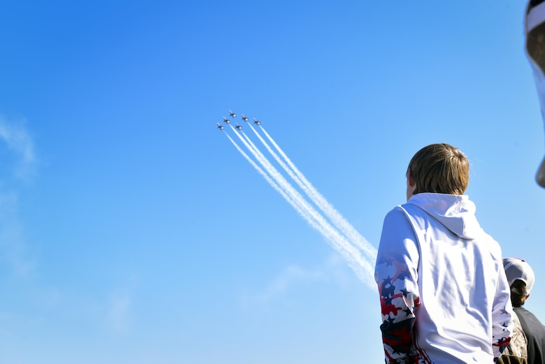 A spectator looks in awe at a performance executed by The U.S. Air Force Thunderbirds Flight Demonstration Team, Oct. 29, 2017, at Moody Air Force Base, Ga. Moody opened its gates to the public for a free, two-day event as a way to thank the local community for their ongoing support of the base's mission. (U.S. Air Force photo by Senior Airman Greg Nash)