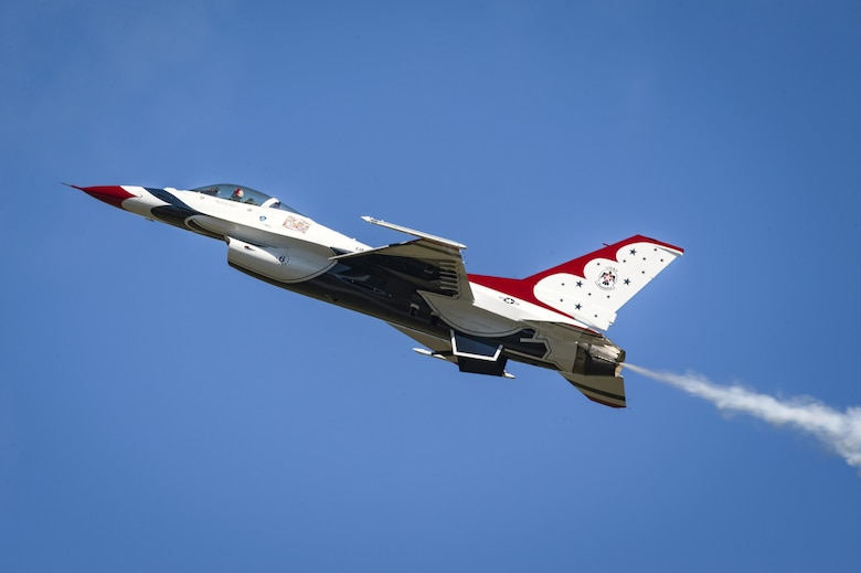 A member of the U.S. Air Force Thunderbirds Flight Demonstration Team soars above 11,000 spectators during the 2017 Thunder Over South Georgia Air Show, Oct. 29, 2017, at Moody Air Force Base, Ga. In addition to aerial performances by military and civilian pilots, attendees viewed aircraft through the ages perform such as the P-51 mustang, a World War II fighter, and Moody's own A-10C Thunderbolt IIs, HH-60 G Pave Hawks and HC-130J Combat King IIs. (U.S. Air Force photo by Senior Airman Greg Nash)