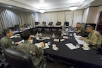 Military leaders conduct a meeting to discuss North Korea.