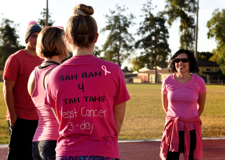 Participants gather at the track before a breast cancer awareness walk-a-thon at Incirlik AB, Turkey, Oct. 27, 2017. Walkers were encouraged to wear pink, which is the chosen color for this cause. (U.S. Air Force photo by Staff Sgt. Rebeccah Woodrow)
