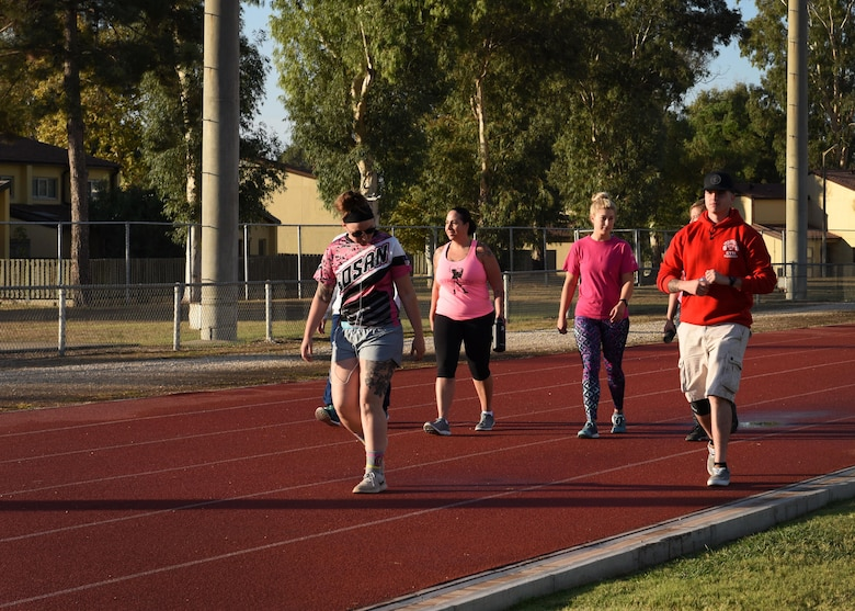 Base members walk around the track for two hours in support of a breast cancer awareness walk-a-thon at Incirlik AB, Turkey, Oct. 27, 2017. October is nationally known as Breast Cancer Awareness month and is meant to bring attention to the need for cancer research and early cancer prevention. (U.S. Air Force photo by Staff Sgt. Rebeccah Woodrow)