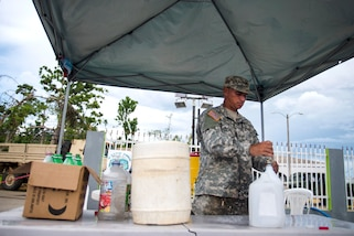 Soldiers purify river water using a tactical water purification unit in Campo Rico, Puerto Rico, Oct. 28, 2017. Photos by Air Force Airman 1st Class Nicholas Dutton