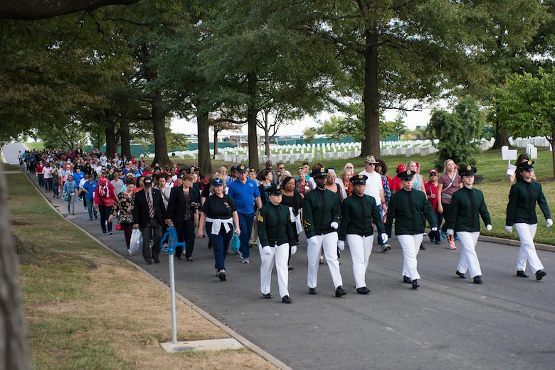 Men and women participate in a half-mile honor walk through Arlington National Cemetery in Washington D.C., Oct. 21, 2017. Nearly 40 Oklahoma Air and Army National Guard women gathered with hundreds of active-duty, retired and reserve servicewomen from all branches of the military to celebrate the 20th anniversary of the dedication of  the Women in Military Service for America Memorial to honor the women who came before them and celebrate the opportunities that are still to come. (U.S. Air National Guard photo by Staff Sgt. Kasey Phipps)