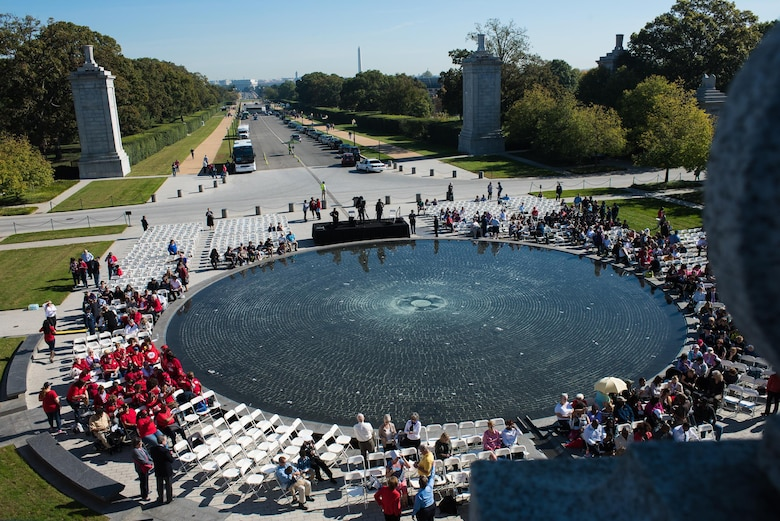Crowds begin to gather in the morning light at the Women in Military Service for America Memorial, the ceremonial entrance to Arlington National Cemetery in Washington D.C. for the 20th anniversary ceremony, Oct. 21, 2017. Nearly 40 Oklahoma Air and Army National Guard women gathered with hundreds of active-duty, retired and reserve servicewomen from all branches of the military to celebrate the 20th anniversary of the dedication of the memorial to honor the women who came before them and celebrate the opportunities that are still to come. (U.S. Air National Guard photo by Staff Sgt. Kasey Phipps)