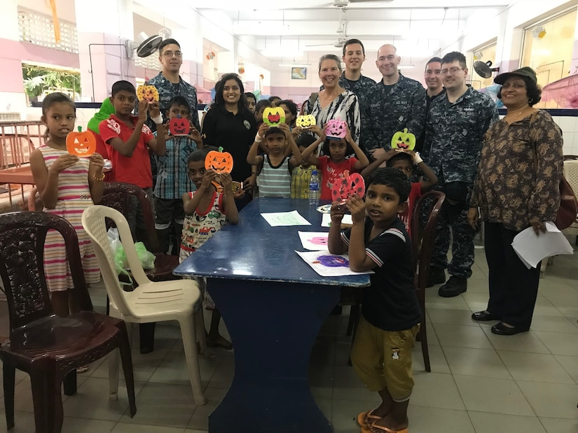 Sailors, embassy volunteers and patients display crafts made during visit to Sri Lankan children's hospital.