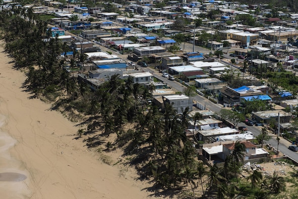 An aerial view of blue roofs on homes that the U.S. Army Corps of Engineers in partnership with FEMA built for residents of Puerto Rico who were affected by Hurricane Maria. (U.S. Air Force photo by Airman 1st Class Nicholas Dutton)