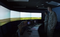 U.S. Air Force Senior Airman Vincent Magenti, an air traffic controller, and Airman 1st Class Tyler Abell, an air traffic controllers assigned to the 6th Operations Support Squadron, focus on a simulated air field during an air traffic control simulator scenario at MacDill Air Force Base, Fla., Oct. 27, 2017. The simulator is a tool used by Airmen to train and demonstrate proficiency in numerous situations, prior to working in the field. (U.S. Air Force photo by Senior Airman Mariette Adams)
