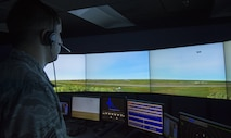U.S. Air Force Senior Airman Vincent Magenti, an air traffic controller assigned to the 6th Operations Support Squadron, tracks an aircraft flying into the MacDill air space during a training scenario in the simulator at MacDill Air Force Base, Fla., Oct. 27, 2017. Air traffic controllers are responsible for monitoring the air space to keep missions running safely and effectively. (U.S. Air Force photo by Senior Airman Mariette Adams)