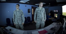 U.S. Air Force Senior Airman Vincent Magenti, an air traffic controller, and Airman 1st Class Tyler Abell, an air traffic controller apprentice, both assigned to the 6th Operations Support Squadron, perform an air traffic control simulator scenario at MacDill Air Force Base, Fla., Oct. 27, 2017. The simulator uses five screens and nine computers to provide the training to air traffic controllers on a daily basis. (U.S. Air Force photo by Senior Airman Mariette Adams