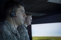U.S. Air Force Senior Airman Vincent Magenti, an air traffic controller assigned to the 6th Operations Support Squadron, communicates to simulated pilots during an air traffic control simulator scenario at MacDill Air Force Base, Fla., Oct. 27, 2017. The simulator uses a replicated MacDill air field layout, voice recognition technology and customized scenarios to give controllers a realistic environments. (U.S. Air Force photo by Senior Airman Mariette Adams)