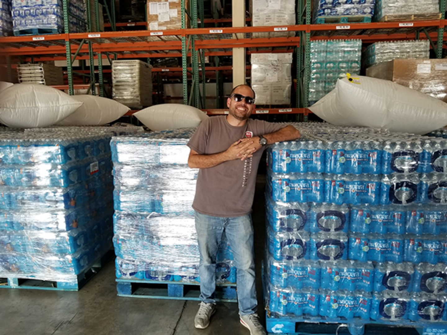 Defense Contract Management Agency Los Angeles employee Efrain Vega De Varona, who is a quality engineer, has distributed food and water in Puerto Rico to help with the hurricane relief efforts since Hurricane Maria caused major damage to the island. (Courtesy photo by Efrain Vega De Varona)