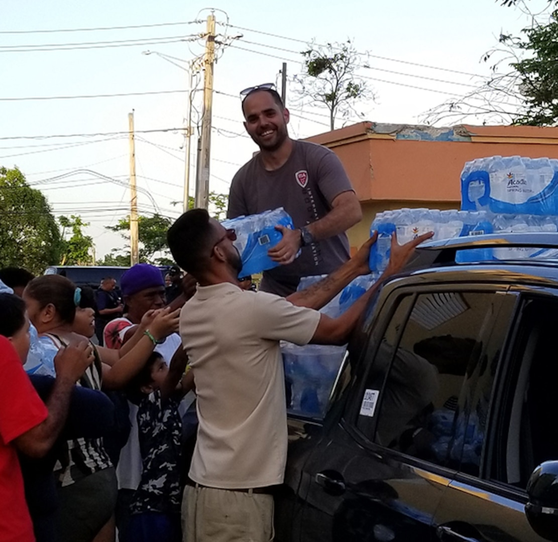 Defense Contract Management Agency Los Angeles employee Efrain Vega De Varona, who is a quality engineer, has distributed food and water in Puerto Rico to help with the Hurricane Maria relief efforts. He is from San Juan, Puerto Rico. (Courtesy photo by Efrain Vega De Varona)