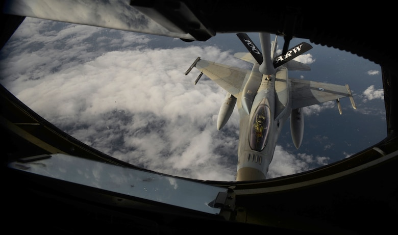 A U.S. Air Force KC-135 Stratotanker refuels a Hellenic air force F-16C Fighting Falcon Oct. 26, 2017, over the Mediterranean Sea. This refueling was in support of a training exercise among the two countries. The 100th Air Refueling Wing operated from Athens, Greece, for the first time. (U.S. Air Force photo by Senior Airman Tenley Long)