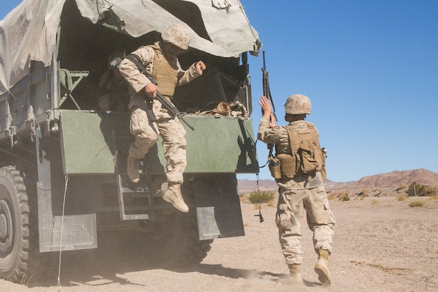 Marines with Combat Logistics Battalion 5, which is based out of Marine Corps Base Camp Pendleton, Calif., conduct a training exercise at Range 114 aboard the Marine Corps Air Ground Combat Center, Twentynine Palms, Calif., Oct. 21, 2017. CLB-5's training, which was part of Integrated Training Exercise 1-18, was focused on using compact metal detectors to detect improvised explosive devices, evacuating personnel from a vehicle that had been struck by an IED and moving a convoy through a kill zone after receiving contact. (U.S. Marine Corps photo by Lance Cpl. Isaac Cantrell)