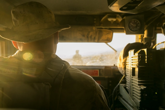 Lance Cpl. Allen Russell, motor vehicle operator, Combat Logistics Battalion 5, which is based out of Marine Corps Base Camp Pendleton, Calif., drives toward Range 114 aboard the Marine Corps Air Ground Combat Center, Twentynine Palms, Calif., Oct. 21, 2017. CLB-5's training, which was part of Integrated Training Exercise 1-18, was focused on using compact metal detectors to detect improvised explosive devices, evacuating personnel from a vehicle that had been struck by an IED and moving a convoy through a kill zone after receiving contact. (U.S. Marine Corps photo by Lance Cpl. Isaac Cantrell)