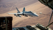 An F/A-18C Hornet assigned to Marine Fighter Attack Squadron 115 conducts aerial refueling during Integrated Training Exercise (ITX) 1-18 over Marine Corps Air Ground Combat Center, Twentynine Palms, Calif., Oct. 28, 2017.