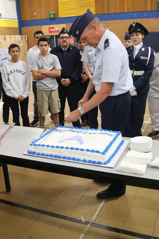 JrROTC Commander Cuts 70th AF Birthday Cake