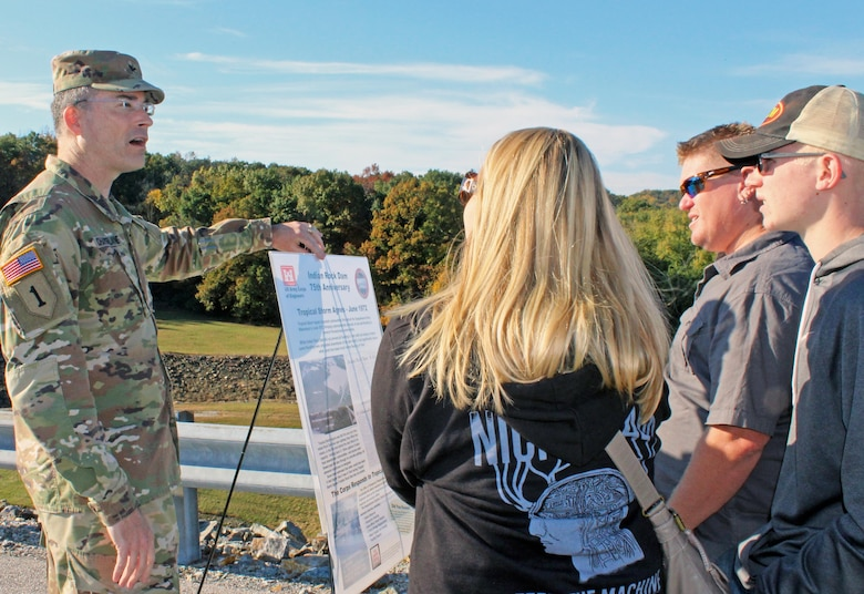U.S. Army Corps of Engineers, Baltimore District, Commander Col. Ed Chamberlayne talks about the history of Indian Rock Dam with area community members atop the dam during an open house to commemorate the dam's 75th anniversary Saturday October 28, 2017. Several hundred people visited the dam to learn about its years of reducing flood risks to downstream communities and partake in the unique opportunity to see the inside of its gatehouse.