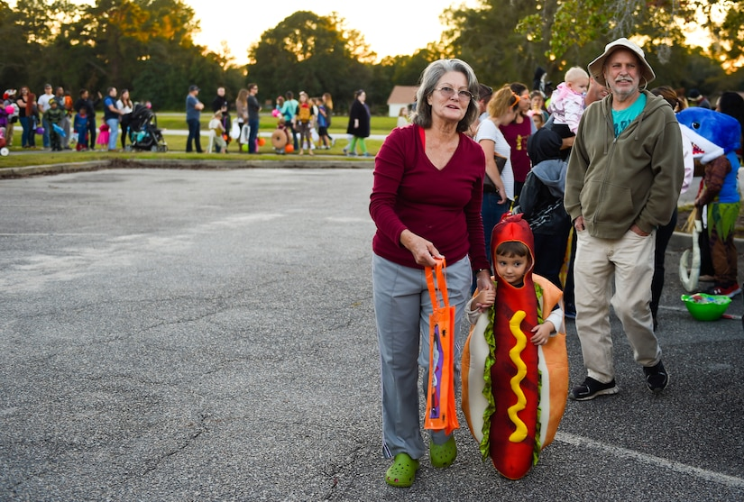 Fall Fest attendees stand in line to trunk-or-treat outside the library at Joint Base Charleston, S.C., Oct. 27, 2017.