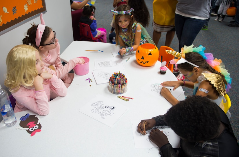 Children color in artwork at the library at Joint Base Charleston, S.C., Oct. 27, 2017.