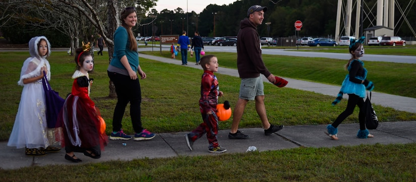Fall Fest attendees leave the event with smiles on their faces outside the library at Joint Base Charleston, S.C., Oct. 27, 2017.