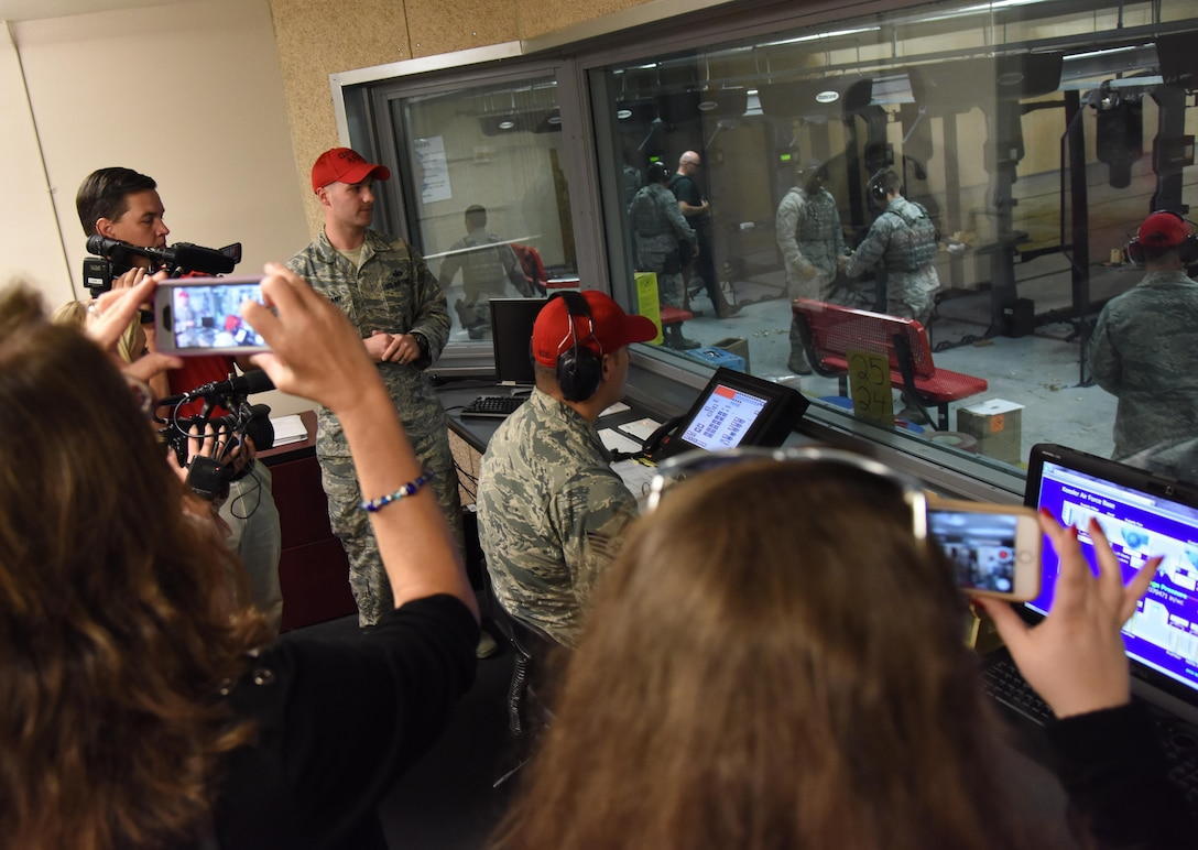 Reporters from local media outlets tour the 81st Security Forces Squadron indoor firing range during Media Day Oct. 26, 2017, on Keesler Air Force Base, Mississippi. In order to better understand Keesler's mission, the reporters also toured the air traffic control tower, the Keesler Medical Center and a 333rd Training Squadron cyber training course. (U.S. Air Force photo by Kemberly Groue)