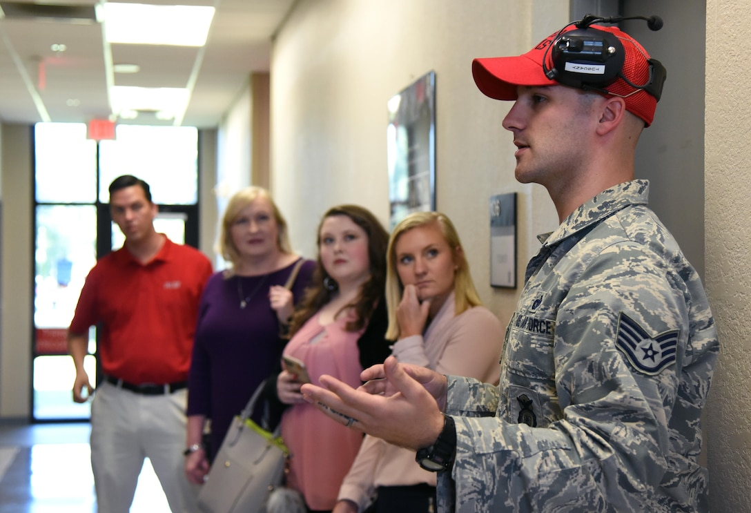 Staff Sgt. Jeffrey Tuscany, 81st Security Forces Squadron combat arms NCO in charge, briefs reporters from local media outlets during a tour the 81st SFS indoor firing range during Media Day Oct. 26, 2017, on Keesler Air Force Base, Mississippi. In order to better understand Keesler's mission, the reporters also toured the air traffic control tower, the Keesler Medical Center and a 333rd Training Squadron cyber training course. (U.S. Air Force photo by Kemberly Groue)