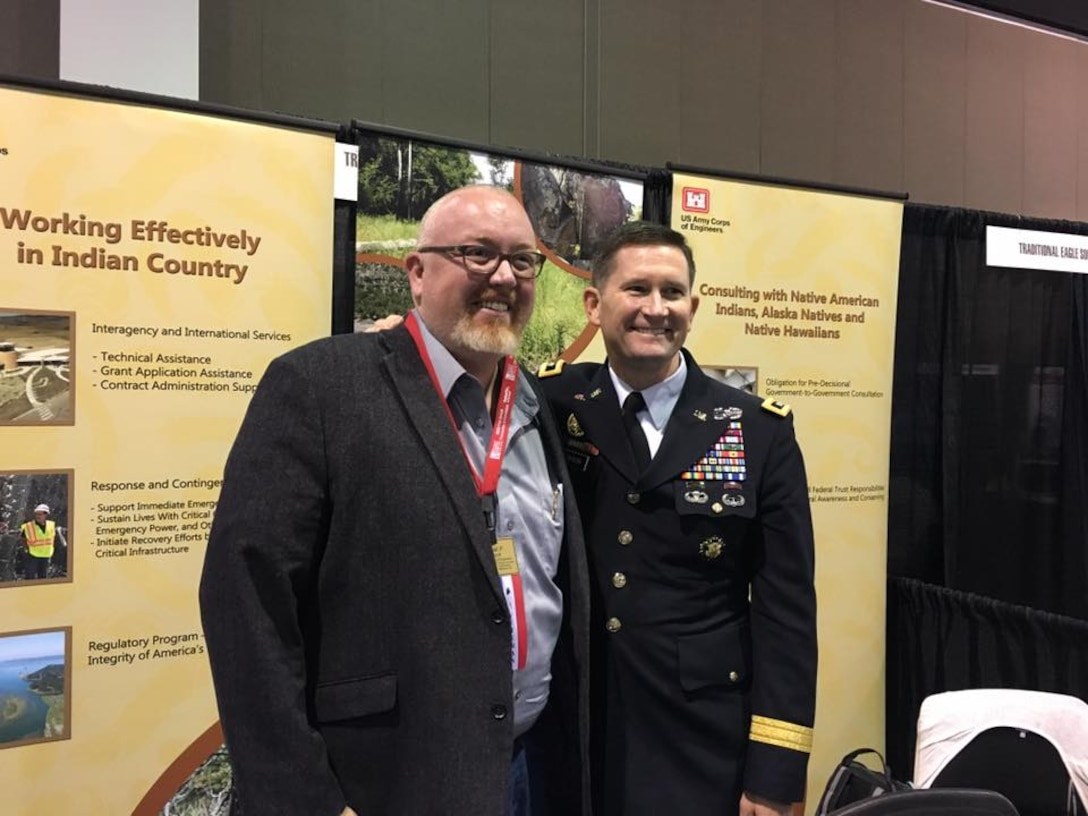 At left, Michael Fedoroff briefs Deputy Commanding General Maj. Gen. Donald Jackson while discussing Tribal Nations Technical Center work at the National Congress of the American Indian held in Milwaukee, Wis. (Courtesy photo)