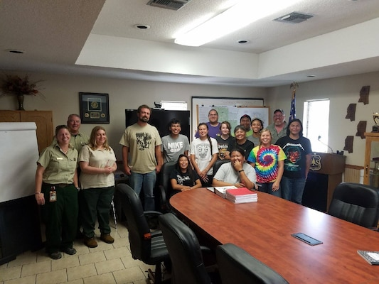 Michael Fedoroff poses with the Historic Preservation staff and children from the Choctaw Nation of Oklahoma, the TNTCX, and the U.S. Forest Service. The photo was taken at the Desoto National Forest after a field visit to Choctaw Ancestral lands.