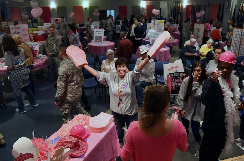 Martha Prieto-Moreno, 81st Medical Group patient advocate, welcomes personnel to the 6th Annual Mammothon Cancer Screening and Preventative Health Fair at the Don Wylie Auditorium Oct. 27, 2017, on Keesler Air Force Base, Mississippi. The 81st Medical Group hosted the walk-in event which included screenings for multiple types of cancer and chronic diseases in honor of Breast Cancer Awareness Month. Flu shots were also provided upon request. (U.S. Air Force photo by Kemberly Groue)