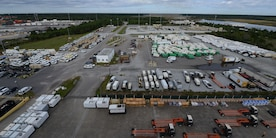 Generators, vehicles, temporary living facilities and others sit waiting to be loaded onto Military Sealift Command's USNS Brittin at Joint Base Charleston Naval Weapons Station, S.C., Oct. 28, 2017.