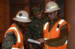 U.S. Navy Sailors assigned to U.S. Navy Cargo Handling Battalion 1 from Yorktown Naval Weapon Station, Virginia, review shipment layout plans on Military Sealift Command's USNS Brittin at Joint Base Charleston Naval Weapons Station, S.C., Oct. 29, 2017.