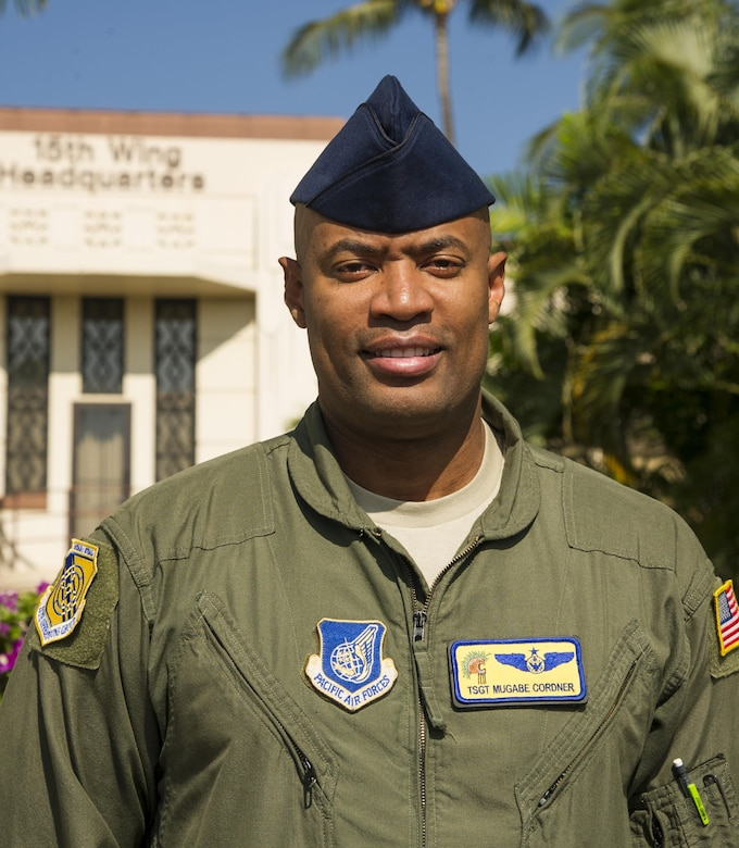 Tech. Sgt. Mugabe Cordner, 15th Operations Group evaluator flight engineer, stands  in front of the 15th Wing Headquarters building on Joint Base Pearl Harbor-Hickam, Oct. 30, 2017. Cordner stopped and de-escalated a fight on board United Airlines flight 534 from Honolulu, Hawaii, to Los Angeles, California, on August 21, 2017. (U.S. Air Force photo by Tech. Sgt. Heather Redman)