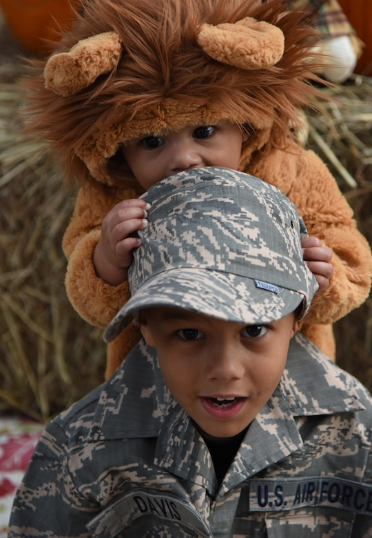 "Deron and Isaiah Davis, sons of Master Sgt. Glenn Davis, 335th Training Squadron personnel apprentice course NCO in charge, pose for a photo during Ghouls in the Park at Marina Park Oct. 27, 2017, on Keesler Air Force Base, Mississippi. Ghouls in the Park also featured an alien bus, a haunted house, ""Trunk or Treat"" and games for children of all ages. (U.S. Air Force photo by Kemberly Groue)"