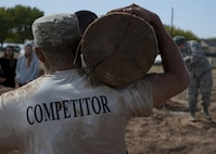 "Members of the 377th Weapons Systems Security Squadron carry a log during the ""Team Punisher"" portion of the Manzano Challenge at Kirtland Air Force Base, N.M., Oct. 27. The competition featured Airmen from across the 377th Security Forces Group divided into teams of four to compete on 13 stations. (U.S. Air Force photo by Staff Sgt. J.D. Strong II)"