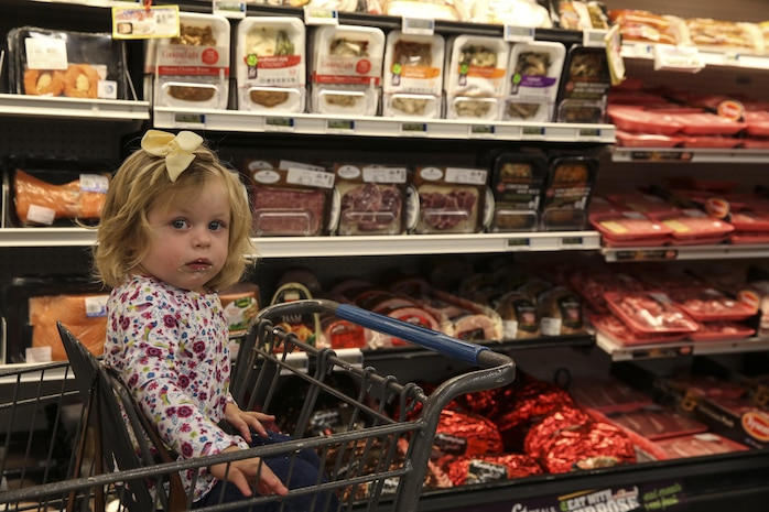 Quinn Prosper, daughter of Jina Prosper, Combat Center patron, attends the reopening of the Combat Center's Commissary, Oct. 21, 2017. The command and DeCA worked diligently to restore the facility to the standards the patrons expect and deserve. (U.S. Marine photo by Pfc. Margaret Gale)