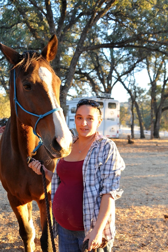 Veronica Mollema, Chairman of the Dry Creek Saddle Club, poses with her horse Fign