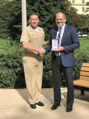 Mr. Tony Haag was awarded the Navy Superior Civilian Service Award on Oct. 26 2017 in a formal ceremony in Washington D.C. Pictured with Haag is CAPT Joel Davis, OPNAV N2N6F33.